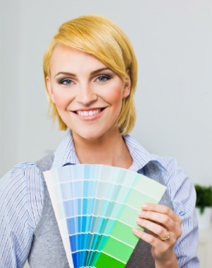 Woman with color swatch book